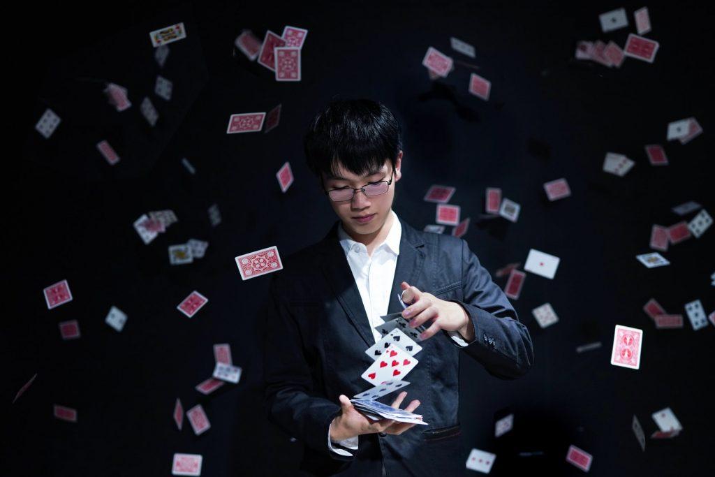 a magician produces a card like a teacher produces their academic content